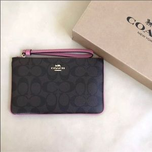 Coach Signature Wristlet brown / pink